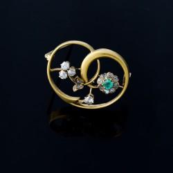 Broche floral con diamantes y esmeralda.